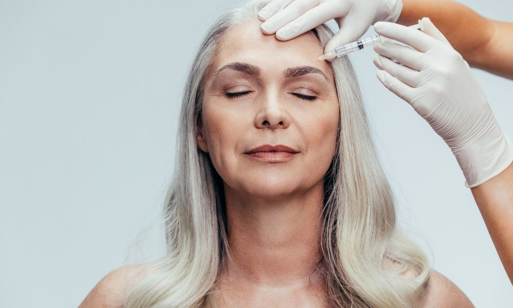 Middle Aged female receiving botox or injectible fillers