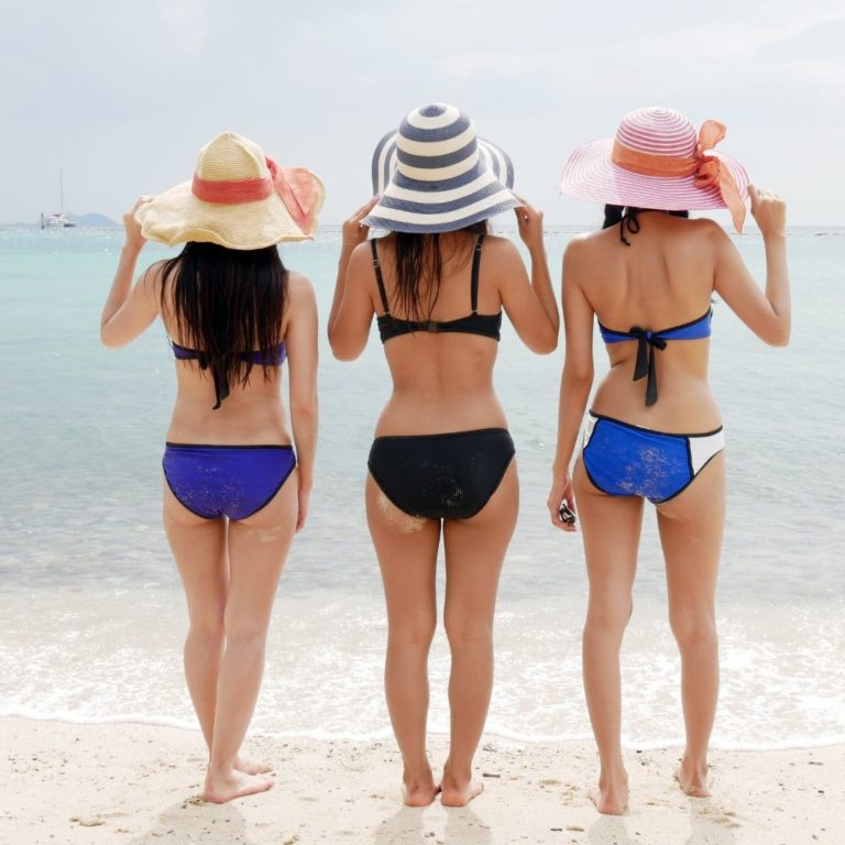 3 Females in Swimming Suits Without Cellulite
